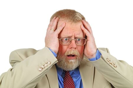 woeful: Close up portrait of distressed businessman with hands on his face, white background.