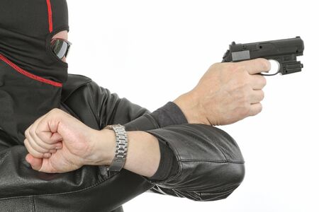 Criminal theme - gangster with a gun studio isolated Stock Photo - 6865965