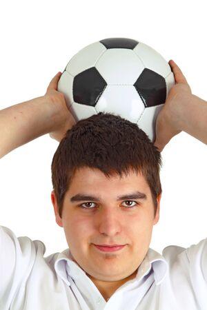 mann: Junger Mann mit Fussball auf hellem Hintergrund