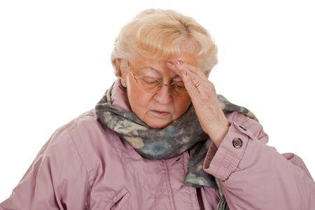 Female senior with coat- got a bad cold-isolated on white background photo