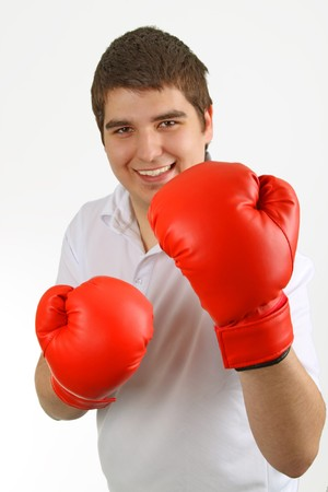 Casual man in red boxing gloves. Isolated over white background. Stock Photo - 7619037