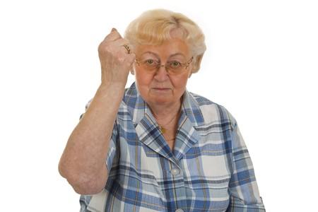 positiv: Female senior showing fist - isolated on white background