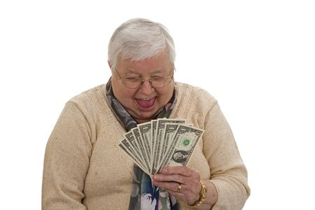 Old woman holding dollars and laughing - isolated on white   photo
