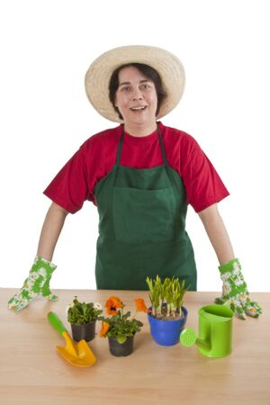 Woman gardener with garden tool isolated on white background. photo