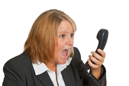 Angry businesswoman on phone isolated on white background photo