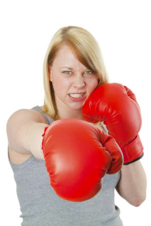 Young woman with red boxing gloves - isolated on white  photo