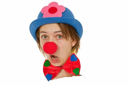 clown nose: Clown with red nose looking out of white paper