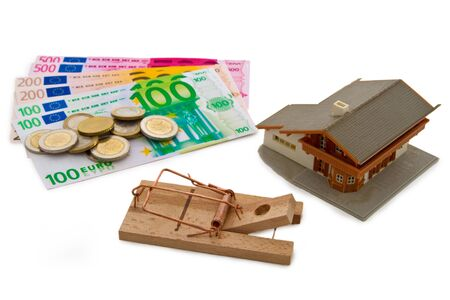 modell: Modell house with euro banknotes and trap on bright background