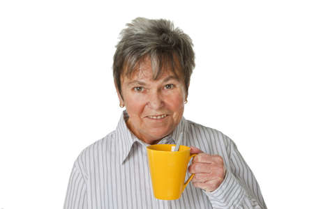 Female senior with cup of coffee isolated on white background photo