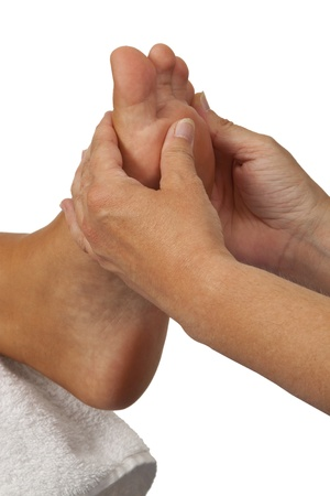 hand rubbing: Person relaxing getting a massage on the foot  Stock Photo
