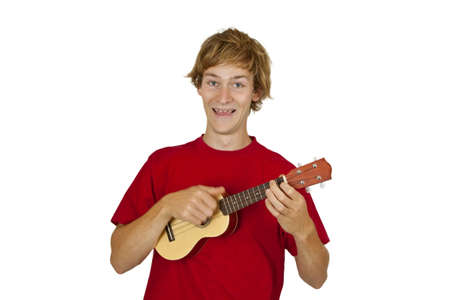 Young man with ukulele isolated on white background photo