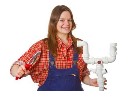 wrech: Friendly female plumber with pipe wrech and syphon isolated on white background