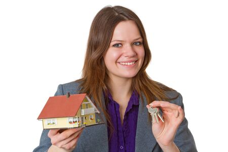 modell: Female real estate agent with keys and modell house over white background