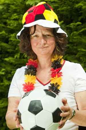 exaltation: Female soccer fan with hat- outdoor shot