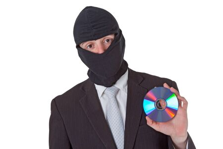 Thief holding a data disk isloated on white background Stock Photo - 9157557