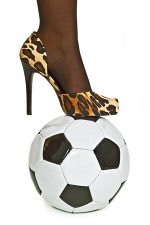 woman foot: Sexy woman foot with high heels and soccer ball on white background Stock Photo