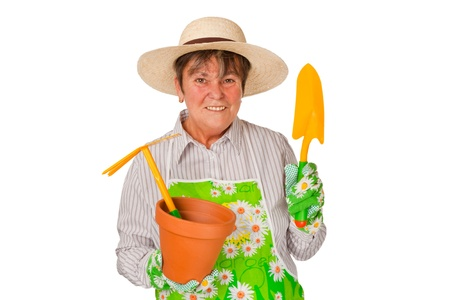 l natural: Female senior with garden tools - isolated on white background