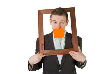 Friendly businessman with wooden frame isolated on white background Stock Photo - 9283374