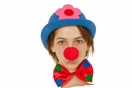 Clown with red nose looking out of white paper photo