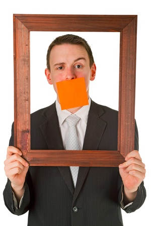 Friendly businessman with wooden frame isolated on white background Stock Photo - 9418744