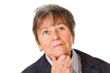 desconfianza: Pensamiento senior femenino en desconfianza - ioslated sobre fondo blanco Foto de archivo