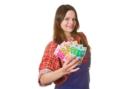 workwoman: Young friendly craftswoman with euro banknotes isolated on white background Stock Photo