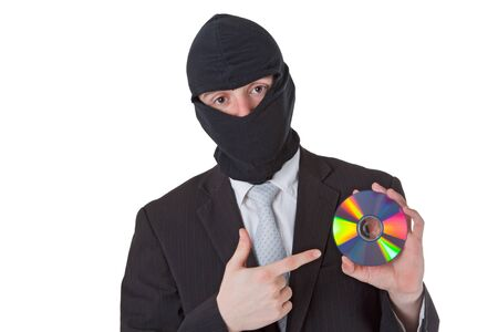 Thief holding a data disk isloated on white background photo