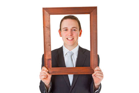 Friendly businessman with wooden frame isolated on white background Stock Photo - 9590280