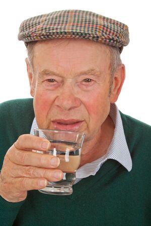 Male senior drinking water isolated on white background photo