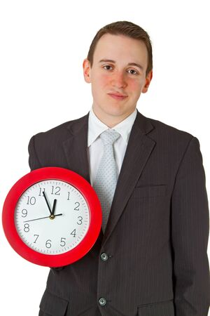 Young businessman, stressed holding a clock.  photo
