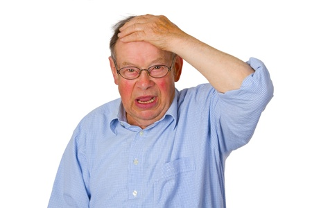 upset man: Male senior isolated on white background.
