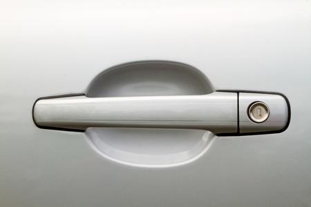 Abstract photo of car door handle and lock
