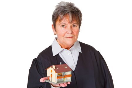 modell: Female laywer with modell house - isolated on white background Stock Photo