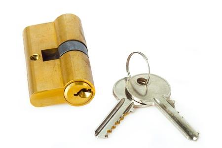 Key cylinder with keys on white background  Imagens