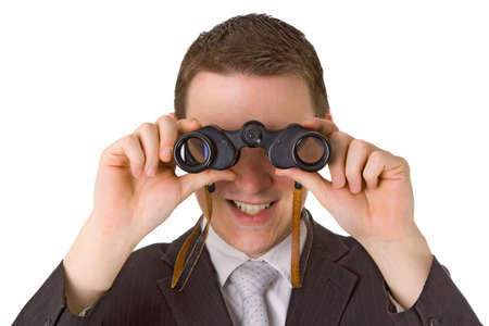 Young businessman with binoculars isolated on white background Stock Photo - 11535087