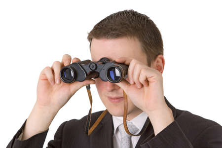 Young businessman with binoculars isolated on white background Stock Photo - 11838190