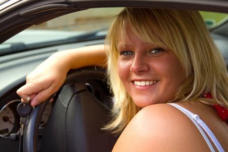 Beautiful woman driver  in open top convertible. photo