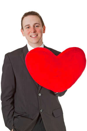 Picture of handsome man with red heart shaped pillow - isolated on white background   photo