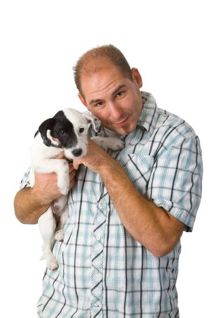 Young man is holding his sweet puppy isolated on white background  photo