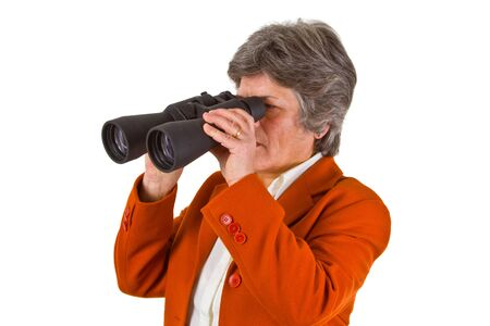 Female senior business woman with binoculars looking to the future Stock Photo - 12684987