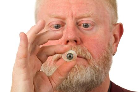 oculist: Oculist holding glass eye - isolated on white background. Stock Photo