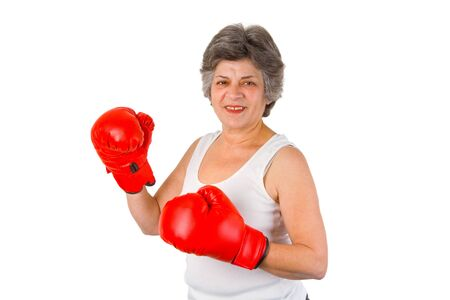 Female senior with red box gloves - isolated on white backgroound photo
