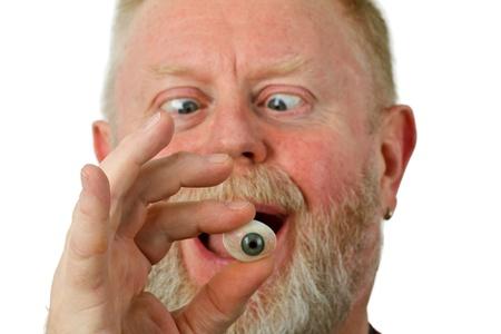 Oculist holding glass eye - isolated on white background Stock Photo - 13464283