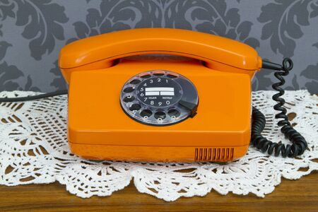 Retro telephone on floral wallpaper photo