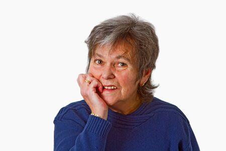 skepticism: Thoughtful female senior isolated on white background Stock Photo