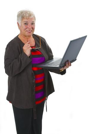 Female senior with laptop - isolated on white background photo