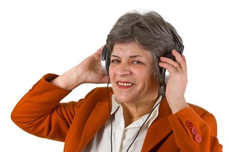 Female senior with headphone - isolated on white background photo