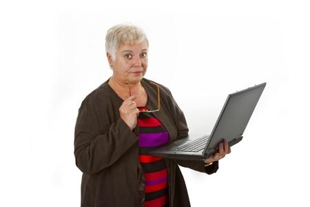 skeptic: Female senior with laptop - isolated on white background Stock Photo