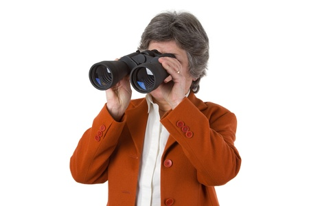 Female senior business woman with binoculars looking to the future photo