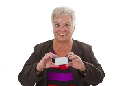 Female senior with business card - isolated on white background photo